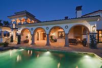 Illuminated swimming pool of luxury mansion
