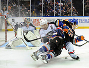 New York Islanders' Mike Halmo (43) and Columbus Blue Jackets' Mark Letestu (55) collide on the ice as Blue Jackets goalie Sergei Bobrovsky defends during an NHL hockey game on Sunday, March 23, 2014, in Uniondale, N.Y. (AP Photo/Kathy Kmonicek)