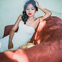 A bride in thoughtful mood on her wedding day, Casa Felix, Olivella, Sitges, Spain.