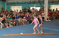 """Gracie Stephen and Lyla McSheffrey get on the balance beam during the """"Gymmy's"""" floor time at Lakes Region Gymnastics Friday evening.  (Karen Bobotas/for the Laconia Daily Sun)"""