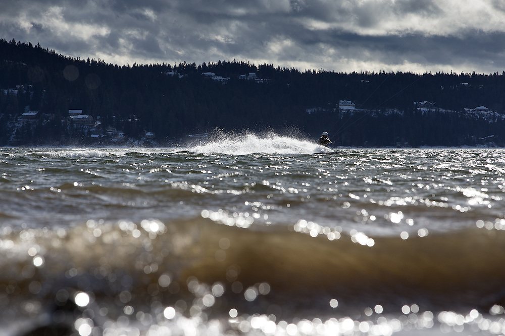 GABE GREEN/Press<br /> <br /> Jeff Yates takes a day off from his job at Parker Subaru to kiteboard the turbulent waters of Lake Coeur d&rsquo;Alene Wednesday afternoon. &ldquo;It&rsquo;s perfect weather, the best day ever. I got to do the snow yesterday and water today,&rdquo;&nbsp;said Yates.