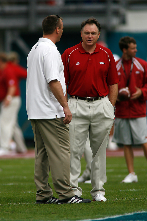 University of Wisconsin head coach Bret Bielema chats with University of Arkansas head coach Houston Nutt before the Wisconsin Badgers 17-14 victory over the Arkansas Razorbacks in the Capital One Bowl at the Florida Citrus Bowl Stadium in Orlando, Florida on January 1, 2007.
