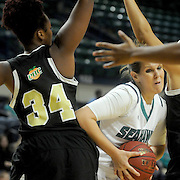 UNCW's Sarah Myatt drives on UNCP's Phoenicia Lawson Sunday November 16, 2014 at Trask Coliseum in Wilmington, N.C. (Jason A. Frizzelle)