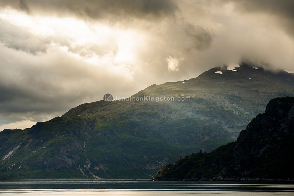 Dramatic light on mountains in Glacier Bay National Park, Alaska.