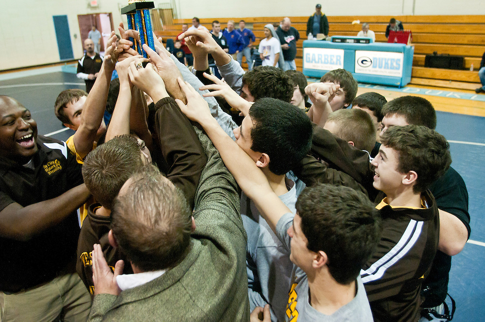 Lathan Goumas | The Bay City Times..The Bay City Western High School wrestling team celebrates their win of the Bay County wrestling championships which were held at Garber High School in Essexville, MI. on Saturday December 17, 2011.
