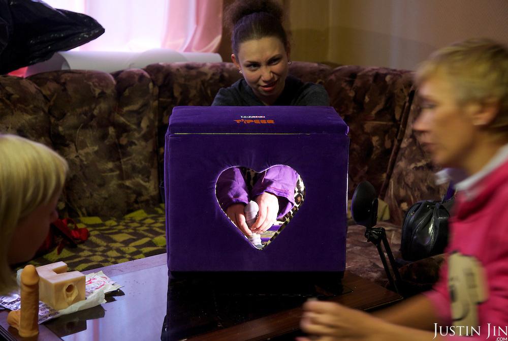 Irina Maslova (RIGHT), HIV activist, demonstrates correct condom use.