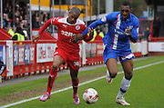 Lewis Young and Amari'i Bell jostle for posession during the Sky Bet League 1 match between Crawley Town and Gillingham at the Checkatrade.com Stadium, Crawley, England on 28 March 2015. Photo by Michael Hulf.