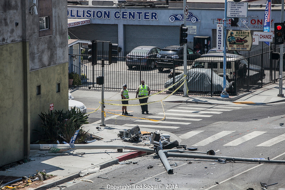 A stolen Tesla automobile wrecked on La Brea Ave in LA after a police chase.  The stolen Tesla, with two car thieves on board, hit two vehicles, with five people in them, and then a traffic light pole. The Tesla was split in<br /> half, with the back half wedged into outdoor alcove between two walls at the Congregation Kol Ami synagogue. The Tesla was reported to have hit speeds as high as 100mph during the chase.