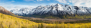 Composite panorama of Polar Bear and Eagle Peaks and Hurdygurdy Mountain overlooking Eagle River Valley in Chugach State Park in Southcentral Alaska. Spring.