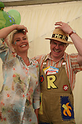 Kim Wilde and Mr. Rotavator, KIM WILDE TO HOSTS RHS ÔA MAGICAL GARDEN PARTY' -HAMPTON COURT PALACE FLOWER SHOW, 2 JULY 2007. DO NOT ARCHIVE-© Copyright Photograph by Dafydd Jones. 248 Clapham Rd. London SW9 0PZ. Tel 0207 820 0771. www.dafjones.com.