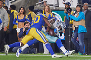 Jan 13, 2019; Los Angeles, CA, USA; Dallas Cowboys wide receiver Michael Gallup (13) makes a catch against Los Angeles Rams free safety Lamarcus Joyner (20) during an NFC Divisional playoff football game against the Dallas Cowboys at Los Angeles Memorial Coliseum. The Rams defeated the Cowboys 30-22. (Robin Alam/Image of Sport)