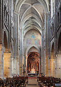 Nave of the Church of Saint-Germain-d'Auxerre, 12th century, with its rib-vaulted ceiling and Gothic arches, looking towards the Chapel of the Virgin, in Dourdan, Essonne, France. The church was begun in 1150 and was badly damaged in the Hundred Years War and Wars of Religion, but restored in the 17th century. It is dedicated to Saint Germain, bishop of Auxerre 418-448 AD. In 1648 Anne of Austria donated 4 columns which were incorporated into the Chapel of the Virgin, built 1689 and forming the chevet of the church, increasing its length to 50m. The church was listed as a Historic Monument in 1967. Picture by Manuel Cohen