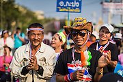"""29 DECEMBER 2013 - BANGKOK, THAILAND:  Anti-government protestors near Democracy Monument in the old part of Bangkok protest against the ruling Pheu Thai party. Protest leader and former Deputy Prime Minister Suthep Thaugsuban announced an all-out drive to eradicate the """"Thaksin regime."""" The anti-government protesters have vowed to continue their protests even though the government has been dissolved and new elections called for in February. The protests have been ongoing in Bangkok since November and are growing increasingly violent.            PHOTO BY JACK KURTZ"""