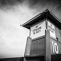 Lifeguard tower #10 in Newport Beach on Balboa Peninsula in Orange County Southern California in the USA. Has copy space for adding text. Photo is high resolution and black and white.