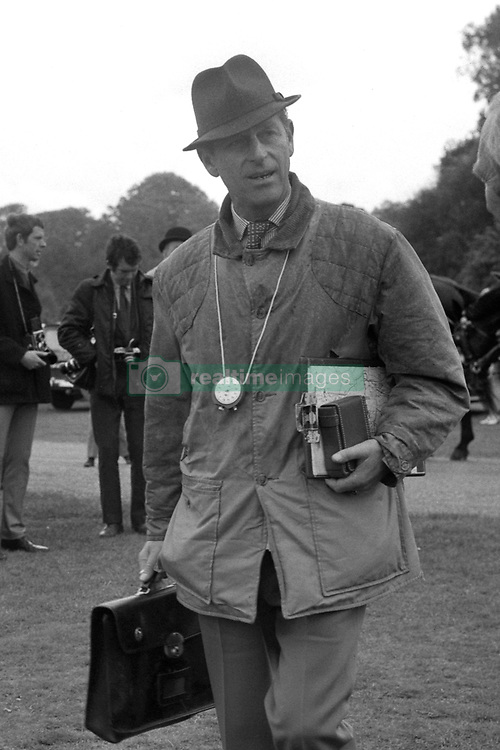 Carrying his necessary equipment, The Duke of Edinburgh carries out his role as Referee for today's Barclays Bank International Driving Grand Prix at Windsor Great Park.