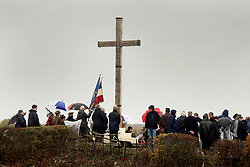 11 November 2018. Lochnagar Crater, La Boisselle, Somme, France. <br /> <br /> Gathered in the pouring rain, those who perished in the Great War are remembered by British and French civilians on the 100th anniversary of the Great War. <br /> <br /> Lochnagar Crater was created by the Tunnelling Companies of the Royal Engineers under a German field fortification. The explosion was the loudest man made noise created at that time, purportedly heard in London. <br /> <br /> Photo©; Charlie Varley/varleypix.com