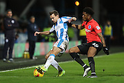 Huddersfield Town midfielder Jonathan Hogg (6) and Brighton & Hove Albion striker (on loan from Arsenal) Chuba Akpom (28) during the EFL Sky Bet Championship match between Huddersfield Town and Brighton and Hove Albion at the John Smiths Stadium, Huddersfield, England on 2 February 2017.