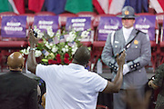 Mourners pray during the funeral service for slain State Senator Clementa Pinckney at the TD Arena June 24, 2015 in Charleston, South Carolina. Pinckney is one of the nine people killed in last weeks Charleston church massacre.