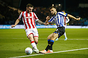 Morgan Fox of Sheffield Wednesday and Thomas Edwards of Stoke City during the EFL Sky Bet Championship match between Sheffield Wednesday and Stoke City at Hillsborough, Sheffield, England on 22 October 2019.