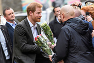 Copenhagen, Denmark, Wednesday 25th October 2017<br /> <br /> HRH Prince Harry of Wales receives a bouquet of flowers from supporters outside KPH Projects in Copenhagen. Harry paid a visit to the centre during a two-day official trip to the Danish capital.<br /> <br /> © Matthew James Harrison / Alamy