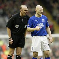 Photo. Aidan Ellis.<br /> Liverpool v Everton.<br /> FA Barclaycard Premiership.<br /> 31/01/2004.<br /> Everton's Thomas Gravesen shares ajoke with Referee Steve Bennett