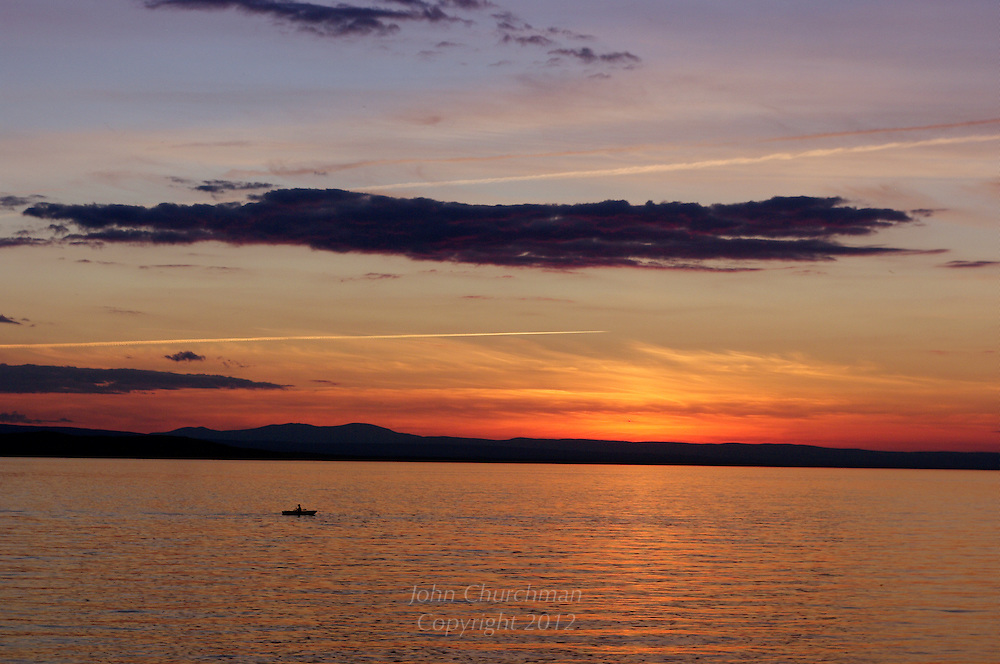 Small rowboat on Lake Champlain, Vermont at Sunset