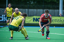 England's Mark Gleghorne goes past Fergus<br /> Kavanagh of Australia. England v Australia, Bisham Abbey, Marlow, UK on 25 May 2014. Photo: Simon Parker