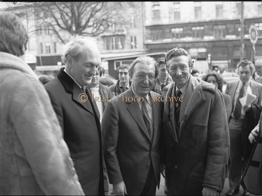 """Opening of New Ogra Fianna Fail office on O'Connell St,Dublin.1982.30.01.1982.01.30.1982.30th January 1982.Photograph of Mr Charles Haughey,.Leader of Fianna Fail,accompanied by Mr George Colley,Deputy Leader and Mr Tom Leonard prospective candidate for Dublin Central arriviving for the opening of the new """"Ogra"""" office."""