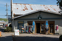 A surf shop housed in an old building offers tourists options in Point Reyes Station, CA.