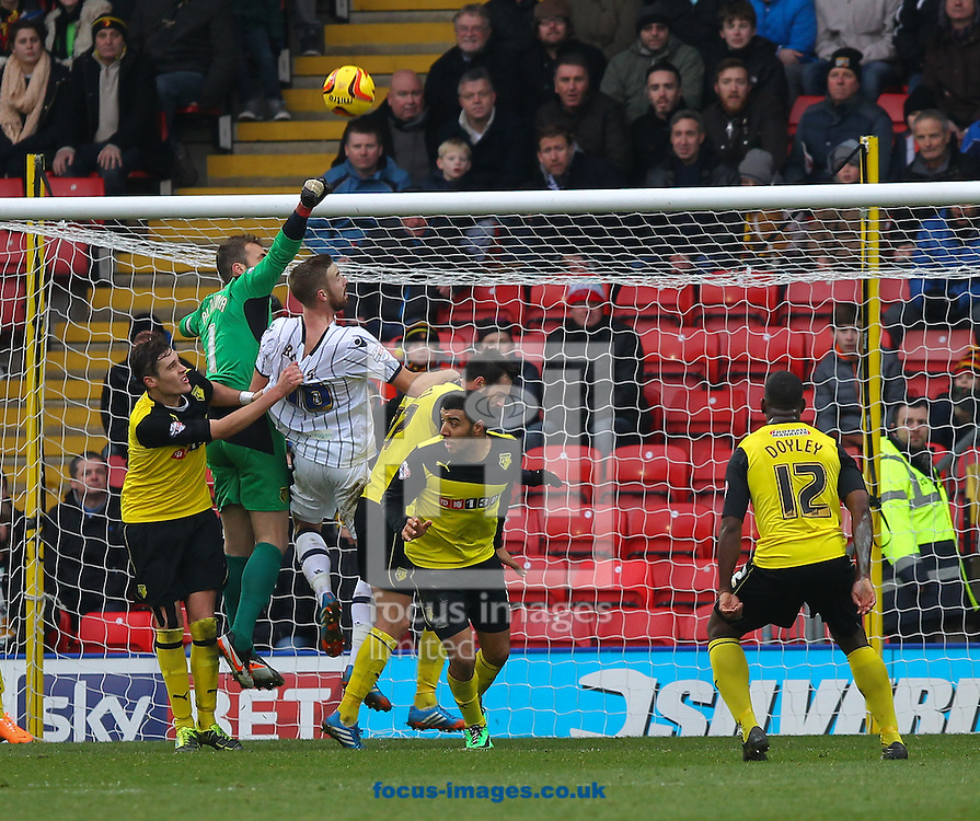 Picture by John Rainford/Focus Images Ltd +44 7506 538356<br /> 26/12/2013<br /> Manuel Almunia of Watford and his defence make sure Mark Bevers of Millwall doesn't get to a corner during the Sky Bet Championship match at Vicarage Road, Watford.