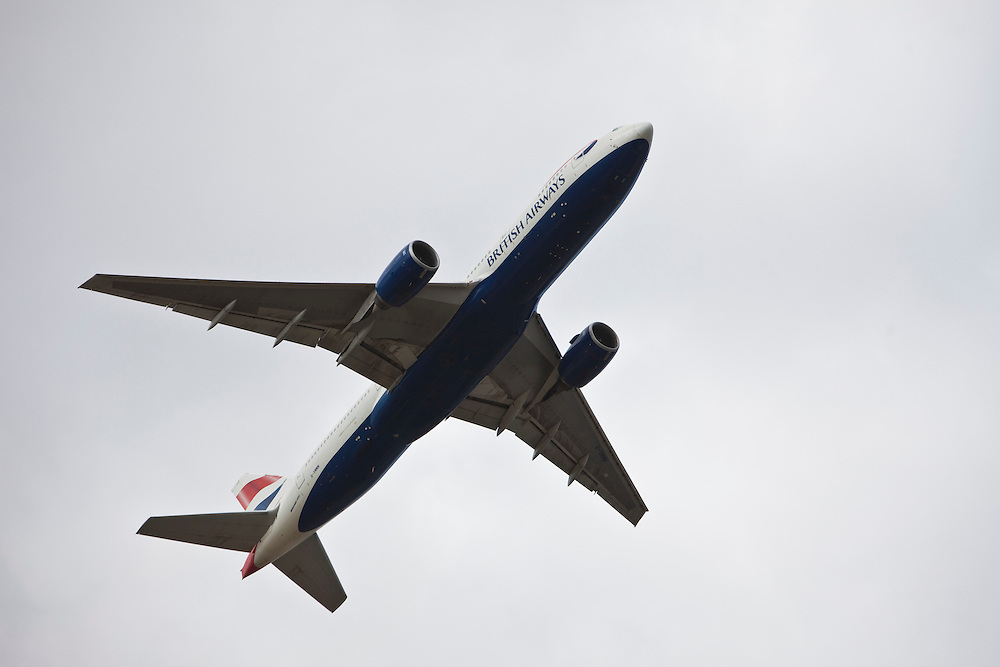 A British Airways Boeing 777 taking off from London Heathrow, south runway. An aeroplane takes off or lands every 90 seconds at  Heathrow, often passing close by to local houses of Hatton.