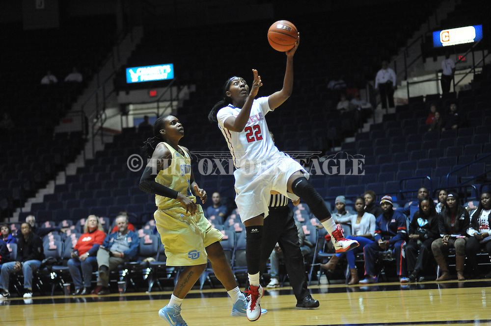 """Ole Miss forward Danielle McCray (22) ecores against Southern University Jaguars' Jasmine Jefferson (15) at the C.M. """"Tad"""" Smith Coliseum in Oxford, Miss. on Thursday, November 20, 2014. (AP Photo/Oxford Eagle, Bruce Newman)"""