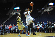 "Ole Miss forward Danielle McCray (22) ecores against Southern University Jaguars' Jasmine Jefferson (15) at the C.M. ""Tad"" Smith Coliseum in Oxford, Miss. on Thursday, November 20, 2014. (AP Photo/Oxford Eagle, Bruce Newman)"