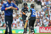 New Zealand Kane Williamson is congratulated by New Zealand Ross Taylor after his 50 during the Royal London One Day International match between England and New Zealand at the Oval, London, United Kingdom on 12 June 2015. Photo by Phil Duncan.