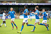 Macclesfield Town forward Arthur Gnahoua celebrate his goal with team-mates during the EFL Sky Bet League 2 match between Macclesfield Town and Colchester United at Moss Rose, Macclesfield, United Kingdom on 28 September 2019.