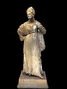 Terracotta statuette of a woman.  Made in Taranto about 330 BC.