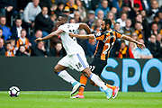 Sunderland forward Victor Anichebe (28) is held by Hull City midfielder Ahmed Elmohamady (27)  during the Premier League match between Hull City and Sunderland at the KCOM Stadium, Kingston upon Hull, England on 6 May 2017. Photo by Simon Davies.