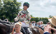 © Licensed to London News Pictures. 31/07/2014. Chichester, UK   Supermodel Edie Campbell after she wins first place in the Ladies Race.  Ladies Day at Glorious Goodwood at Goodwood racecourse in Chichester today 31/07/14. Photo credit : Stephen Simpson/LNP