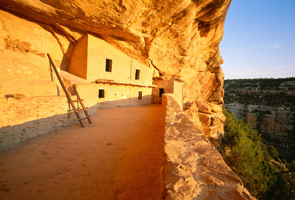 0405-1095 ~ Copyright: George H. H. Huey ~ Balcony House at sunrise. The North Plaza. Anasazi culture cliff dwelling in Soda Canyon, occupied from A.D. 1190-A.D. 1270's. It contained 35-40 rooms and kivas. Mesa Verde National Park, Colorado.