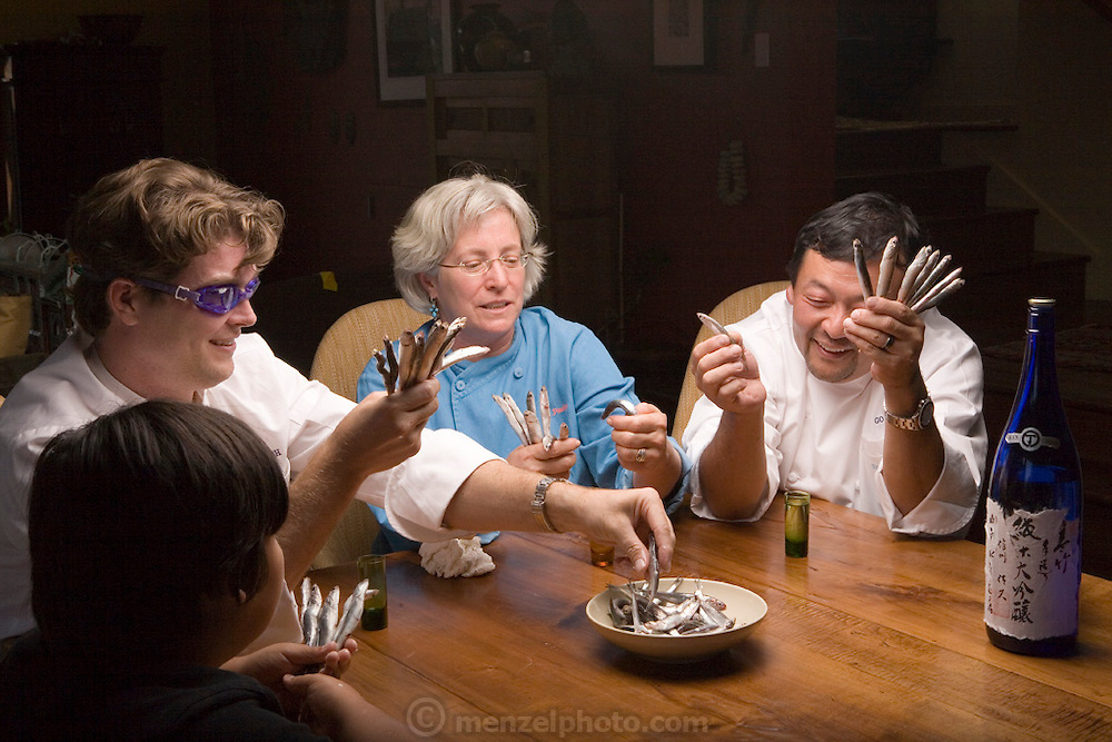 "Sean Knight plays ""Go Fish"" and drinks saki with partners and fellow chefs Cindy Pawlcyn and Ken Tominaga at Cindy's St. Helena home in the Napa Valley, CA. They are about to open a new restaurant in St. Helena, called Go Fish. Also playing is Ken's 9 year old son."