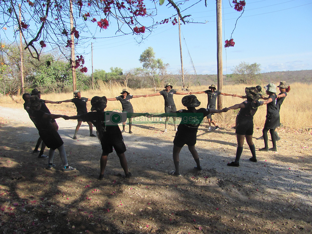 Oct. 2, 2014 - BALULE RESERVE, SOUTH AFRICA: Black Mamba recruits training in the bush. LED BY BRITISH former military personnel these pictures show how courageous women anti-poachers train with guns in their battle to preserve Africa's endangered animals. Operating in the Kruger National Park's Balule Nature Reserve the 24-member strong all-female Black Mamba Anti-Poaching Unit patrols 50,000 hectares of bush to protect elephants and rhinos that are hunted as part of the estimated £12billion a year illegal world animal trade. These ladies, who as pictures show pose with weapons but also know how to party, are on the front line of a deadly war for the resources of their continent. Over the past year 1,000 wildlife rangers have been killed in Africa while protecting endangered wildlife. Black Mamba Commander and former Royal Navy serviceman Russell Baker (28) from Grimsby, UK explained exclusively how and why this South African special unit was established. (Credit Image: © Media Drum World/MediaDrumWorld/ZUMAPRESS.com)