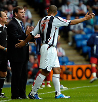 Photo: Ed Godden.<br />West Bromwich Albion v Colchester United. Coca Cola Championship. 19/08/2006. Albion Manager Bryan Robson gives the orders to Nigel Quashie.