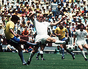 Bobby Charlton of England efends as C Lodoaldo shoots. Brazil v England, World Cup 1970, Mexico, 7th June 1970.