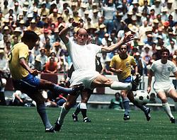 Bobby Charlton of England efends as C Lodoaldo shoots. Brazil v England, World Cup 1970, Mexico, 7th June 1970.