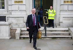 © Licensed to London News Pictures. 22/03/2019. London, UK. Secretary of State for Environment, Food and Rural Affairs Michael Gove leaves the Cabinet Office in Westminster. The EU27 have agreed to Prime Minister Theresa May's request for a short extension to the deadline for leaving the European Union, offering two new deadlines depending on whether she is able to pass her deal next week. Photo credit: Rob Pinney/LNP