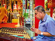 "22 AUGUST 2017 - BANGKOK, THAILAND: A traditional Chinese musician performs during a ceremony on the first day of Hungry Ghost Month at the Poh Teck Tung Shrine in Bangkok's Chinatown. The seventh lunar month (August - September) is when many Chinese believe Hell's gate will open to allow spirits to roam freely in the human world. Many households and temples hold prayer ceremonies throughout the month-long Hungry Ghost Festival (Phor Thor) to appease the spirits. During the festival, believers will also worship the Tai Su Yeah (King of Hades) in the form of paper effigies which will be ""sent back"" to hell after the effigies are burnt.      PHOTO BY JACK KURTZ"