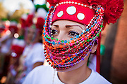 """10 OCTOBER 2010 - PHOENIX, AZ:  SOCORRO LUCERO, a member of the """" Danza Tarahumara Quita Corona"""" dance troupe, at a procession to honor the Virgin of Guadalupe in Phoenix, AZ. About 500 people processed through downtown Phoenix Sunday afternoon to honor the Virgin of Guadalupe, the """"Queen of the Americas."""" The procession was accompanied by 12 Matachine dance troupes. The Matachines are an important part of Mexican Catholic culture. They represent the battle of Good vs. Evil and the protect the Virgin from malevolent forces, represented by the demon like figures who accompany the dancers.      Photo by Jack Kurtz"""