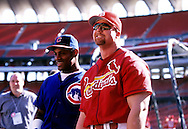 "ST. LOUIS, MO-SEPTEMBER 1998:   Mark McGwire #25 of the St. Louis Cardinals chats with Sammy Sosa of the Chicago Cubs during a game at Busch Stadium in St. Louis, Missouri during the 1998 season.  McGwire and Sosa were part of what has been called the ""Great Home Run Race of 1998"" between the two as they were both attempting to break the single season home run record of 61 held by Roger Maris since 1961.  (Photo by Ron Vesely)"