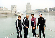 1981 tour of France (La Rochelle). New Zealand All Blacks physio Malcolm Hood, prop John Spiers, captain Graham Mourie, doctor Peter Cunningham. New Zealand All Blacks, Rugby Union. Photo: PHOTOSPORT/Peter Bush