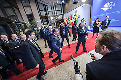Francois Hollande, France's president, center left, and Mario Monti, Italy's prime minister, center right, arrive on the first day of the EU Summit, at the European Council headquarters in Brussels, Belgium on Thursday, Dec. 13, 2012. (Photo © Jock Fistick)